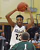 Elijah Bovell #23 of Baldwin looks to make a pass during a non-league game against Harborfields in the Richard Brown Nassau-Suffolk Challenge at Uniondale High School on Saturday, Jan. 14, 2017. Baldwin won by a score of 49-42.