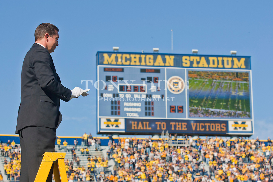 Michigan Marching Band director Scott Boerma conducts the pre-game show before an NCAA college football game with Iowa, Saturday, Oct. 16, 2010, in Ann Arbor, Mich. (AP Photo/Tony Ding)