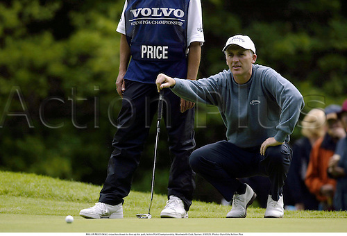 PHILLIP PRICE (WAL) crouches down to line up his putt, Volvo PGA Championship, Wentworth Club, Surrey, 030525. Photo: Glyn Kirk/Action Plus...golf golfer.2003.putting putts.green greens