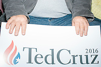 A member of the audience holds a campaign sign as Texas senator and Republican presidential candidate Ted Cruz speaks at a town hall at Crossing Life Church in Windham, New Hampshire, on Tues. Feb. 2, 2016. The day before, Cruz won the Iowa caucus.