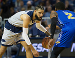 Nevada,s Cody Martin (11) looks to drive against South Dakota State's Corey Henson (2) in the first half of an NCAA college basketball game in Reno, Nev., Saturday, Dec. 15, 2018. (AP Photo/Tom R. Smedes)