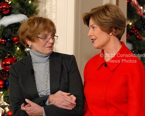 "Washington, DC - December 3, 2008 -- First lady Laura Bush, right, speaks warmly of White House Florist Nancy Clarke, left, as she makes remarks during a media preview of the 2008 holiday decorations and tasting event on the State Floor of the White House in Washington, D.C. on Wednesday, December 3, 2008.  The theme of this years decorations is ""a Red, White, and Blue Christmas""..Credit: Ron Sachs / CNP"