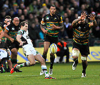Northampton, England. Nick Evans of Harlequins clears the ball during the Aviva Premiership match between Northampton Saints and Harlequins at Franklin's Gardens on December 22. 2012 in Northampton, England.