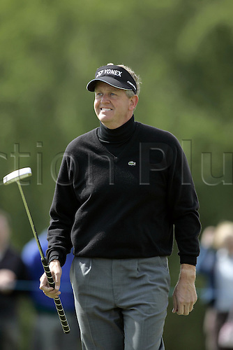 13 May 2005: Scottish golfer Colin Montgomerie smiles as he walks across the green with his putter during the second round of the The Daily Telegraph Dunlop Masters played at the Forest of Arden, Warwickshire. Photo: Neil Tingle/Actionplus..050513 golf golfer player