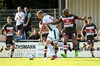 ROTINGHAUSEN - Voetbal, Sankt Pauli - FC Groningen, oefenduel, 01-09-2017, FC Groningen speler Tom van Weert in duel met Christopher Avevor