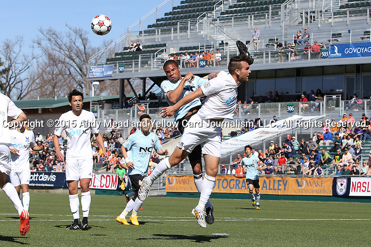 08 March 2015: Carolina's Austen King (right) and E-Land's Ryan Johnson (JAM) (left) challenge for a header. The Carolina RailHawks of the North American Soccer League played Seoul E-Land FC of the K-League Challenge at WakeMed Stadium in Cary, North Carolina in a 2015 preseason friendly for both clubs. The game ended in a 0-0 tie. Afterwards, Seoul E-Land won a penalty kick shootout 5-4.