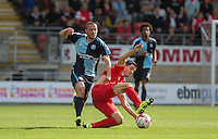 Lloyd James of Leyton Orient jumps in on Michael Harriman of Wycombe Wanderers during the Sky Bet League 2 match between Leyton Orient and Wycombe Wanderers at the Matchroom Stadium, London, England on 19 September 2015. Photo by Andy Rowland.
