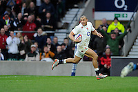Jonathan Joseph of England runs in his second try during the RBS 6 Nations match between England and Italy at Twickenham Stadium on Saturday 14th February 2015 (Photo by Rob Munro)