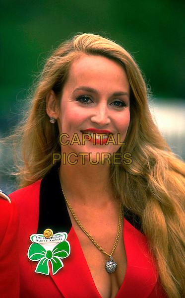 JERRY HALL.Ref: 026.pre 2001 .headshot portrait red  cleavage .CAP/PL.©Phil Loftus/Capital Pictures.