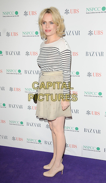 DUFFY (AIMEE ANN DUFFY).The Surrealist Ball in aid of NSPCC at The Banqueting House, London, England..March 17th, 2011.full length beige sheer skirt white blue black stripe top nautical side shoes .CAP/CAN.©Can Nguyen/Capital Pictures.