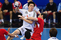 05 APR 2012 - LONDON, GBR - South Korea's Jin-Ho Jung (KOR) tries to shoot during the men's 2012 London Cup match against Tunisia at the National Sports Centre in Crystal Palace, Great Britain (PHOTO (C) 2012 NIGEL FARROW)