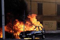 Roma,15 Ottobre 2011.Manifestazione contro la crisi e l'austerità..Corteo e scontri con le forze dell'ordine..Un veicolo in fiamme e la scritta: il Futuro ce lo riprendiamo da soli