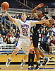 John O'Brien #20 of South Side, left, tries to drive past Alyjah Hill #3 of Hewlett during the Nassau County varsity boys basketball Class A semifinals at Hofstra University on Wednesday, Feb. 24, 2016. Hewlett went to halftime leading 23-20.