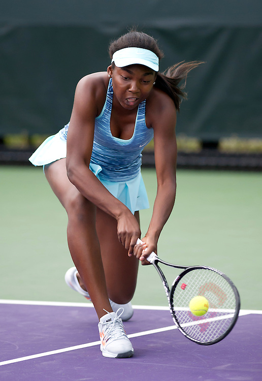 Francoise Abanda (CAN) in action during her defeat by Kimiko Date-Krumm (JPN) in their Womens Qualifying Singles Final Round match today - Kimiko Date-Krumm (JPN) def Francoise Abanda (CAN) 7-6(4) 4-6 6-4<br /> <br /> Photographer Andrew Patron<br /> <br /> Tennis - Sony Open Tennis - ATP World Tour Masters 1000 - Day 2 - Tuesday 18th March 2014 - Tennis Center at Crandon Park Key Biscayne, Miami, Florida USA<br /> <br /> &copy; CameraSport - 43 Linden Ave. Countesthorpe. Leicester. England. LE8 5PG - Tel: +44 (0) 116 277 4147 - admin@camerasport.com - www.camerasport.com