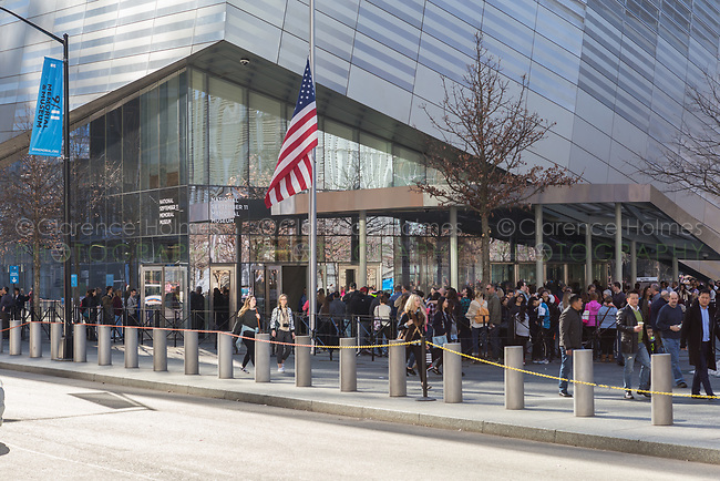 People wait in-line to enter the National September 11 Memorial Museum in New York City.