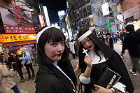 Young Japanese women dressed as nuns enjoy the Halloween celebrations in Shibuya. Saturday October 28th 2017