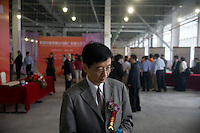 "Visiting dignitaries enter the Amity Printing Company's new printing facility for the inauguration ceremony for the new press in Nanjing, China...On May 18, 2008, the Amity Printing Company in Nanjing, Jiangsu Province, China, inaugurated its new printing facility in southern Nanjing.  The facility doubles the printing capacity of the company, now up to 12 million Bibles produced in a year, making Amity Printing Company the largest producer of Bibles in the world.  The company, in cooperation with the international organization the United Bible Societies, produces Bibles for both domestic Chinese use and international distribution.  The company's Bibles are printed in Chinese and many other languages.  Within China, the Bibles are distributed both to registered and unregistered Christians who worship in illegal ""house churches."""