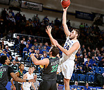 BROOKINGS, SD - DECEMBER 12: Mike Daum #24 from South Dakota State lays the ball up over Conner Avants #32 from North Dakota during their game Tuesday night at Frost Arena in Brookings, SD. (Photo by Dave Eggen/Inertia)