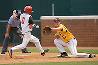 Matt Wessinger #0 of the St. John's Red Storm heads back to first base as Brent Mikionis #27 of the VCU Rams waits for the throw at the Charlottesville Regional of the 2010 College World Series at Davenport Field on June 5, 2010, in Charlottesville, Virginia.  The Red Storm defeated the Rams 8-6.  Photo by Brian Westerholt / Four Seam Images