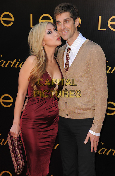 ETTY FARRELL & PARRY FARRELL.The 3rd Annual Leveday Hosted by Cartier held at a private estate in Bel Air, California, USA..June 18th, 2008.half 3/4 length perry married husband wife red burgundy silk satin dress low cut cleavage neckline brown cardigan black trousers clutch bag.CAP/DVS.©Debbie VanStory/Capital Pictures.