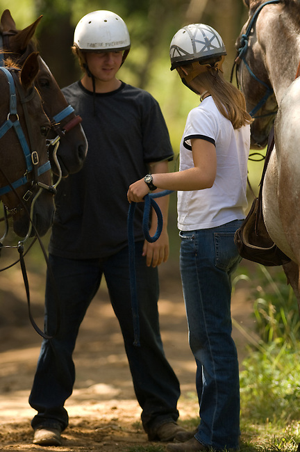 Teen kids with horses at Cheley Camp, portrait, summer, Estes Park, Colorado, not released