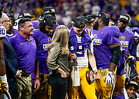 ATLANTA, GA - DECEMBER 7: Joe Burrow #9 of the LSU Tigers celebrates after winning the MVP trophy during a game between Georgia Bulldogs and LSU Tigers at Mercedes Benz Stadium on December 7, 2019 in Atlanta, Georgia.