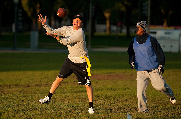 UNITED STATES - OCTOBER 04:  Rep. Bobby Schilling, R-Ill., catches a pass during a congressional football practice on the Mall in preparation for the upcoming game between members of Congress and the Capitol Police.  (Photo By Tom Williams/Roll Call)