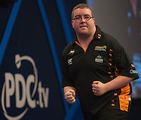29.12.2014.  London, England.  William Hill World Darts Championship.  Stephen Bunting (27) [ENG] celebrates a winning leg in his match with James Wade (6) [ENG]. Bunting won the match 3-1