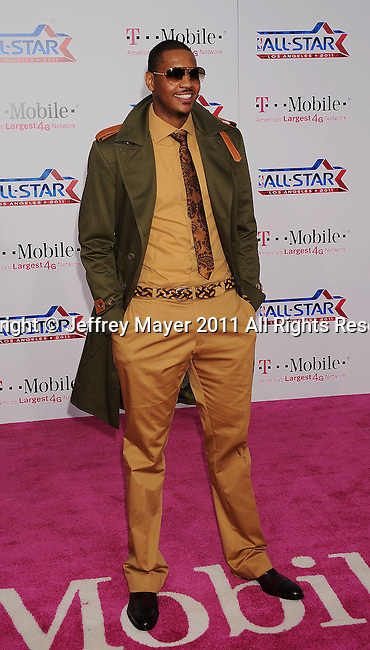 LOS ANGELES, CA - FEBRUARY 20: Carmelo Anthony arrives at the T-Mobile Magenta Carpet at the 2011 NBA All-Star Game at L.A. Live on February 20, 2011 in Los Angeles, California.