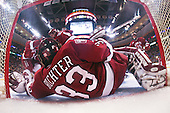 Kyle Richter (Harvard 33) spreads across his net to make a save. The Boston College Eagles defeated the Harvard University Crimson 6-5 in overtime on Monday, February 11, 2008, to win the 2008 Beanpot at the TD Banknorth Garden in Boston, Massachusetts.