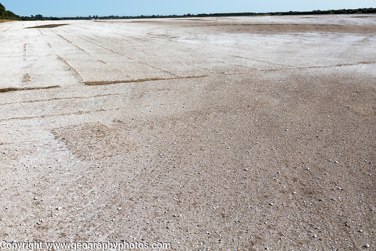 Chalk spread on field after turf grass harvest to decrease soil acidity, Sutton Heath, Suffolk Sandlings, England, UK