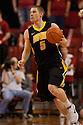 29 February 2012: Matt Gatens #5 of the Iowa Hawkeyes brings the ball down court against the Nebraska Cornhuskers at the Devaney Sports Center in Lincoln, Nebraska. Iowa defeated Nebraska 62 to 53.