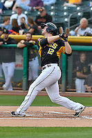 Todd Cunningham (12) of the Salt Lake Bees follows through on his swing against the Albuquerque Isotopes during the Pacific Coast League game at Smith's Ballpark on August 30, 2016 in Salt Lake City, Utah. The Bees defeated the Isotopes 3-2. (Stephen Smith/Four Seam Images)