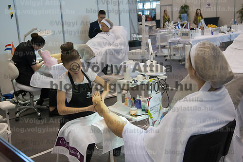Participant competes in pedicure during the EuroSkills European Championship of young professionals in Budapest, Hungary on Sept. 26, 2018. ATTILA VOLGYI