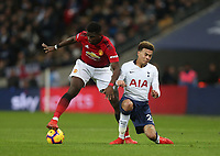Manchester United's Paul Pogba with a challenge on Tottenham Hotspur's Dele Alli<br /> <br /> Photographer Rob Newell/CameraSport<br /> <br /> The Premier League - Tottenham Hotspur v Manchester United - Sunday 13th January 2019 - Wembley Stadium - London<br /> <br /> World Copyright &copy; 2019 CameraSport. All rights reserved. 43 Linden Ave. Countesthorpe. Leicester. England. LE8 5PG - Tel: +44 (0) 116 277 4147 - admin@camerasport.com - www.camerasport.com