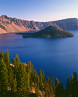 ORCL_083 - USA, Oregon, Crater Lake National Park, Sunrise on west rim of Crater Lake with Hillman Peak (left) and Llao Rock (right) overlooking Wizard Island.