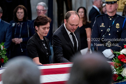 Vladimir Kara-Murza and his wife Yevgenia touch the casket of Sen. John McCain, R-Ariz., as he lies in state in the Rotunda of the U.S. Capitol, Friday, Aug. 31, 2018, in Washington. (AP Photo/Andrew Harnik, Pool)