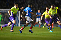 Ellis Harrison of Portsmouth middle is shadowed by Gary Warren of Exeter City left and Tom Parkes of Exeter City right during Portsmouth vs Exeter City, Leasing.com Trophy Football at Fratton Park on 18th February 2020