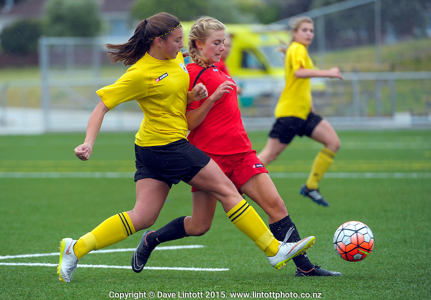 Action from the New Zealand Age Group Championships Girls match between Capital (yellow tops) and Mainland (red) at Fraser Park Artificial Turf, Lower Hutt, Wellington, New Zealand on Wednesday, 16 December 2015. Photo: Dave Lintott / lintottphoto.co.nz