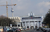 GERMANY, Berlin, Brandenburg Gate with sculpture Quadriga, the roman goddess Victoria is riding a horse-powered wagon bringing peace to the town, built 1789-1793, wrapped during renovation works in 2001 with advertisement of german telecommunication company T online