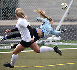 Douglas' Katie Dry watches her shot sail past Carson goalie Emmy Heller during the girls soccer zone championship at Damonte Ranch High School in Reno, Nev. on Saturday, Nov. 5, 2011 . Carson won 2-1..Photo by Cathleen Allison.