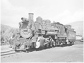 3/4 fireman side view of K-37 #490 at Durango with car shop in the background.<br /> D&amp;RGW  Durango, CO  Taken by Payne, Andy M. - 8/21/1954
