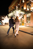 USA, Colorado, Aspen, a man and woman cross Main Street and walk to the J-Bar at the Hotel Jerome in downtown Aspen