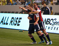 CARSON, CA - March 31, 2012: Kelyn Rowe  (11) and AJ Soares (3) of the Revolution celebrate Rowe's goal during the LA Galaxy vs New England Revolution match at the Home Depot Center in Carson, California. Final score LA Galaxy 1, New England Revolution 3.