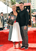 LOS ANGELES, CA. February 05, 2019: Pink & Carey Hart at the Hollywood Walk of Fame Star Ceremony honoring singer Pink.<br /> Pictures: Paul Smith/Featureflash