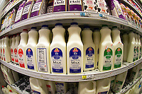 Containers of milk in a supermarket refrigerator are seen on Sunday, November 27, 2011. (© Richard B. Levine)