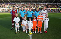 Pictured: Chlidren mascots with team captains and referees before kick off. Sunday 27 November 2011<br /> Re: Premier League football Swansea City FC v Aston Villa at the Liberty Stadium, south Wales.