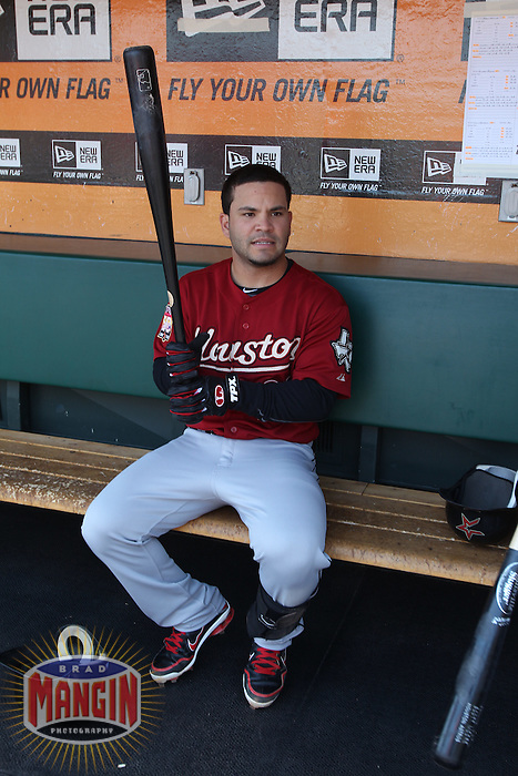 SAN FRANCISCO, CA - JULY 15:  Jose Altuve #27 of the Houston Astros gets ready in the dugout before the game against the San Francisco Giants at AT&T Park on Sunday, July 15, 2012 in San Francisco, California. Photo by Brad Mangin