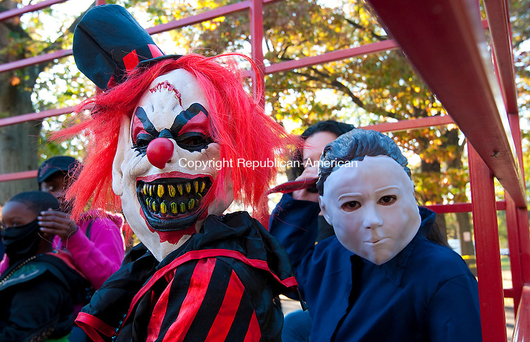 WATERBURY, CT-102514JS05-  Antonio Mejil, 9, left, and Alex Rodriguez, 8, both from Waterbury, donned their scary masks as they take a hayride during the 10th annual Mardi Gross Halloween party Saturday at Library Park in Waterbury. The event was hosted by Spirit of Waterbury. <br /> Jim Shannon Republican-American