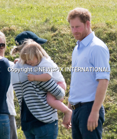 18.06.2016; Westonbirt, UK: PRINCE HARRY BROODY<br />That forlorn looks says it all.<br />With his brother and most of his circle of friends married with kids Prince Harry feels left out.<br />Soon to be 32-years-old there does not appear to be a mate for the Prince.<br />His love of children is plain to see and was again evident when he caught up with his 2-year-old niece Mia Tindal at a charity polo match.<br />Mia is the daughter of cousin Zara Tindall (nee Phillips)<br />Mandatory Credit Photo: &copy;Dias/NEWSPIX INTERNATIONAL<br /><br />(Failure to credit will incur a surcharge of 100% of reproduction fees)<br />IMMEDIATE CONFIRMATION OF USAGE REQUIRED:<br />Newspix International, 31 Chinnery Hill, Bishop's Stortford, ENGLAND CM23 3PS<br />Tel:+441279 324672  ; Fax: +441279656877<br />Mobile:  07775681153<br />e-mail: info@newspixinternational.co.uk<br />Please refer to usage terms. All Fees Payable To Newspix International